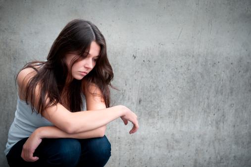 Sad Girl Sitting